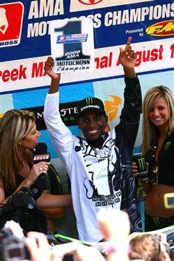 Stewart holds up his first AMA Motocross number one plate.