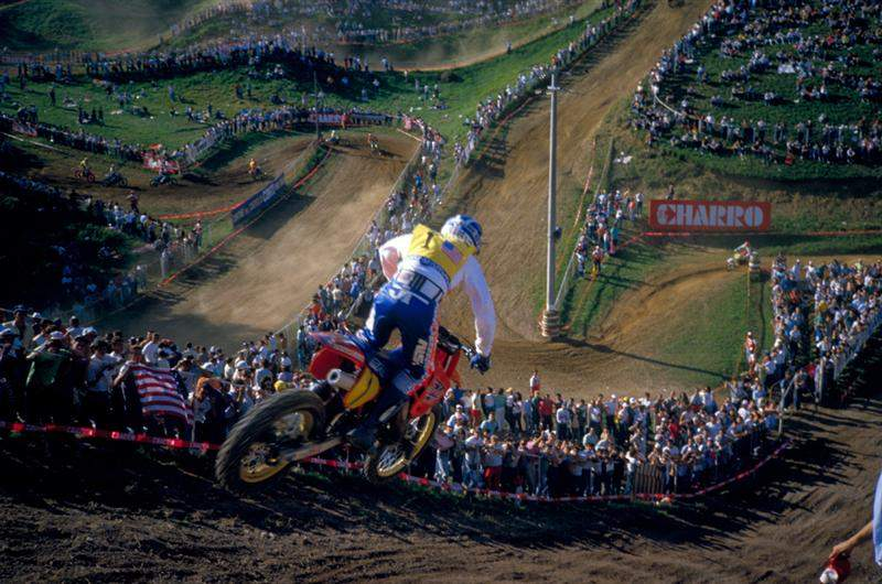 '86 des Nations drop-off. This particular jump was really fun. It was an awesome view and one of the rare places in racing where you just look out at the crowd for a second and really appreciate the moment. I went pretty close to the fence on my right to miss some bumps once and the fans touched me. I changed my line more to the left after that!