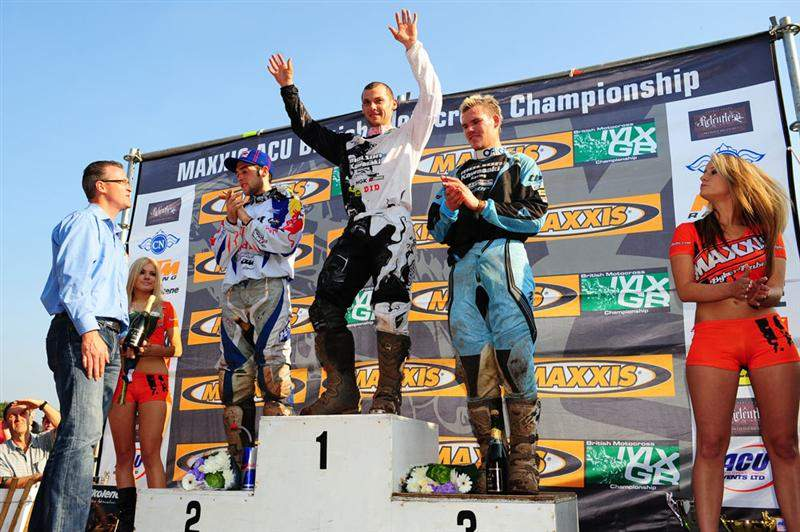 The MX2 podium with Sword on top, flanked by Simpson (left) and Swanepoel (right).