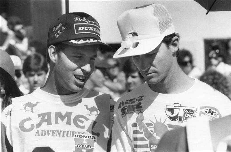 Me and RJ. This was during the opening ceremonies at the '86 Motocross des Nations in Italy. I spotted this guy with a solar-fan hat and traded him my custom Dunlop hat for it. As soon as I went back under the umbrella, it quit, so I think RJ was busting my balls, saying,