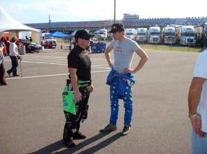 Monster Energy's Ricky Carmichael and Red Bull Racing's Scott Speed talk shop before the race.