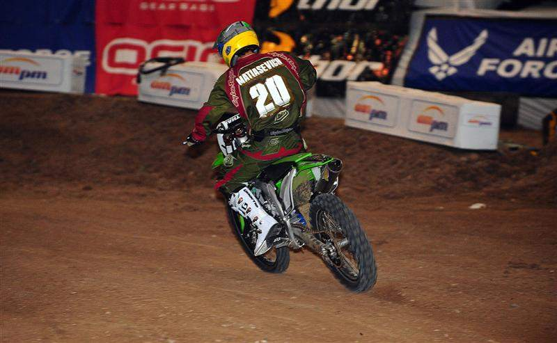 Jeff Matiasevich is riding a Kawasaki KX450F and wearing #20