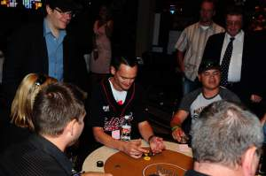 2006 World Series of Poker champion Jamie Gold watches over the shoulder of Jimmy Button