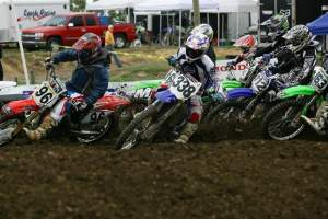 Zach (338) gets the holeshot over Tyler Wharton (96) and the rest of the MX A class