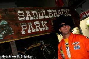 Johnny O'Hannah in front of an original Saddleback sign that probably came out of Stu Peters' garage.