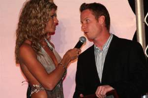 Ferry chats with Erin Bates and her microphone at the banquet
