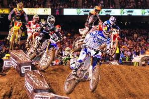 James Stewart (7) grabbed the holeshot in the 450cc main, followed by Josh Grant (33), Chad Reed (1) and the rest of the field.