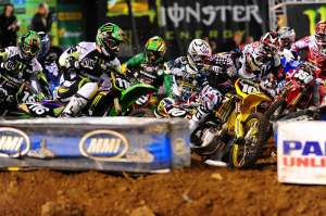 Ryan Dungey (10) fought it out with Ryan Morais (116) for the holeshot at the start of the Lites main.