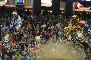 James Stewart (7) fought off Mike Alessi (800) for the holeshot to start the main event.