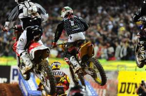 With Stewart out front, Chad Reed (1) started mired in the pack - again.