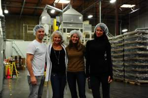 Shane McCassy (far left) and Cytomax VP of Marketing Nikki Brown (second from right) stand between the beautiful Muscle Milk girls from the races. Behind them is the giant mixer. Nice headgear, guys!