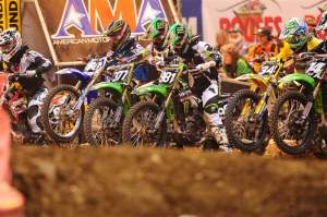 Austin Stroupe (981) got the holeshot in the Lites main.