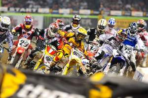 James Stewart (7) pushed Mike Alessi (800) wide to get the holeshot at the start of the 450cc main.
