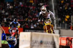 Ryan Dungey (10) chased Jake Moss early in the main.