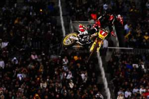 Chad Reed (1) grabbed the holeshot and checked behind him off the track's second triple, finding James Stewart right there.