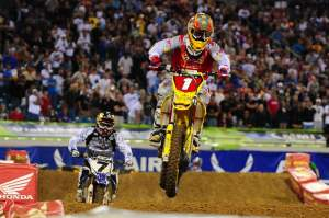 Reed (1) led the first 14 laps of the main event in front of rival James Stewart (7).