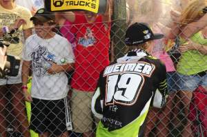 Jake Weimer sprays down a couple of his rabid female fans