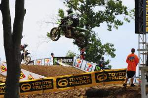 Jake Moss was a contender in moto 1 before his Factory Kawasaki started smoking and he wheelied over backwards.