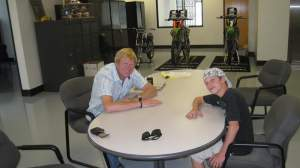 Adam and EJ at the Pro Circuit shop.