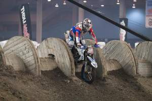 Pretty sure a BMW has never ridden over a giant wooden spool in a supercross before. Guy Giroux on his way to a third.