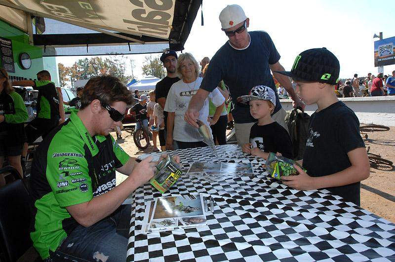 Villopoto signs autographs for fans.