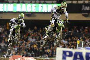 Jake Weimer (12) leads his teammate Josh Hansen (100) early in the race before Hansen fell.