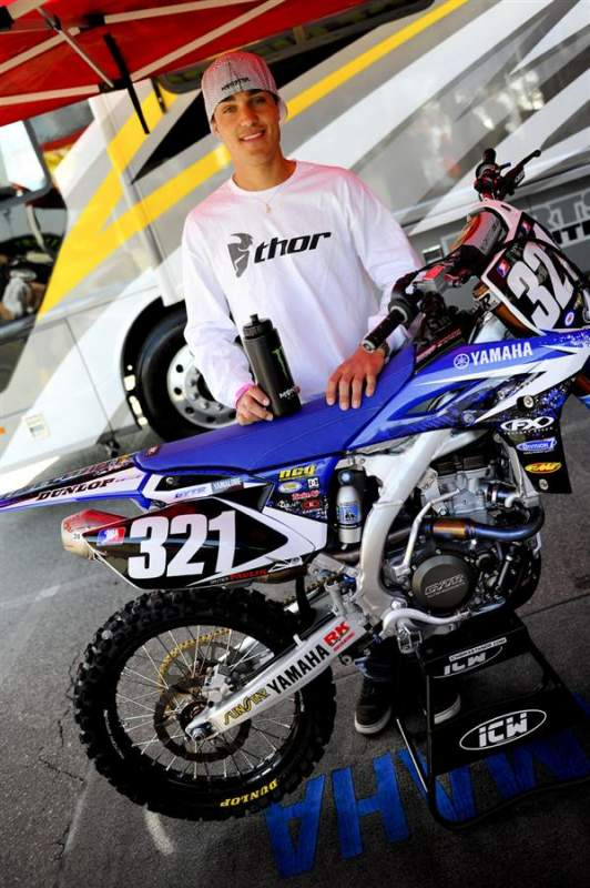 Gautier Paulin is ready for his first ever AMA Supercross. He's pitted behind the Star Racing Yamaha rig, and is being coached by David Vuillemin. And in completely different news, he has the biggest hands in the history of motocross.