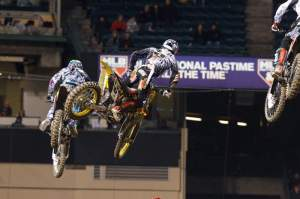 Note the national pastime sign in the background. If we had battles like this every week, supercross would be bigger than baseball.