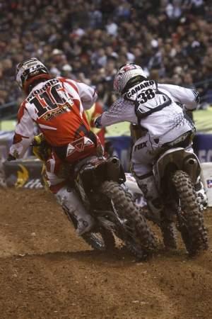 Ryan Morais (116) shoves his way by Trey Canard (38).