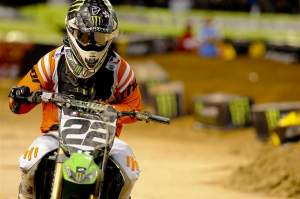 Chad Reed rides off the Phoenix track with his broken left hand at his side.