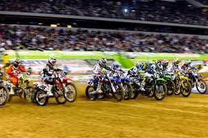 The 450cc class leaves the line and heads to turn one inside Cowboys Stadium in Arlington.