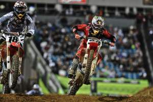 Trey Canard (38) passed his way through the field. Here, he passes temporary teammate Davi Millsaps (18) for fifth.