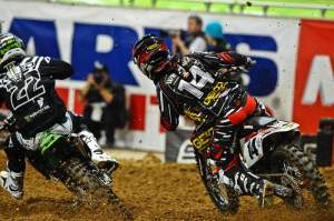 Kevin Windham (14) works his way around the outside of Chad Reed (22) in the main event. Windham ended up second.