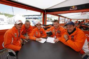 Marvin Musquin signs his 2011-12 contract to race the AMA circuit with help from KTM's Stefan Everts, Pit Beirer, and Heinz Kinigadner.