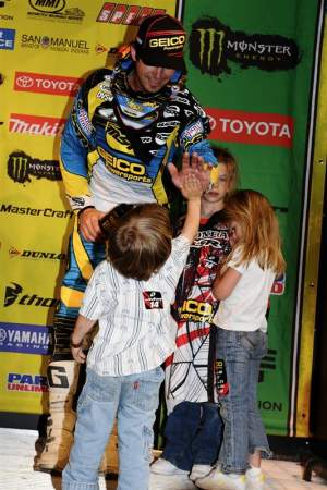 Kevin Windham gives a high five to his son after his second place in Houston.