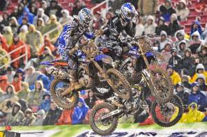 Michael Byrne (26), Justin Brayton (23) and Michael Blose (67) go three-wide off the track's second triple on the first lap. Byrne held third until rear-brake problems dropped him back.
