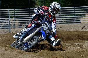 Steve Cox on a YZ144... Looking like a bear on a bicycle at the circus.