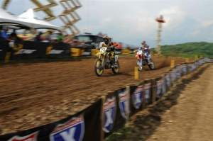 Dungey (5) passes Short (29) for the lead in moto two.