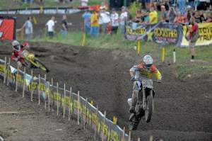 Josh Grant (33) came from behind to win the first moto over Dungey (5).