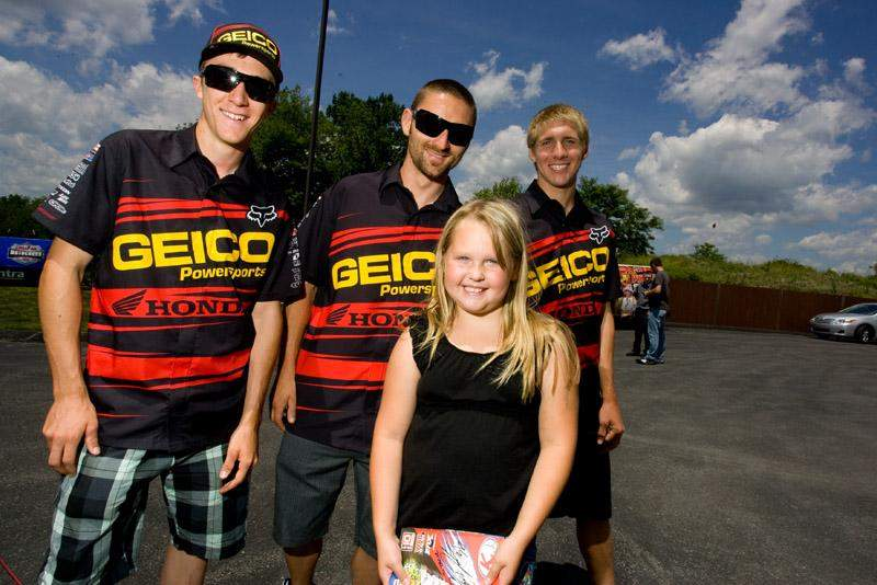 A lucky fan posed for a photo with the Geico Powersports Honda Team.