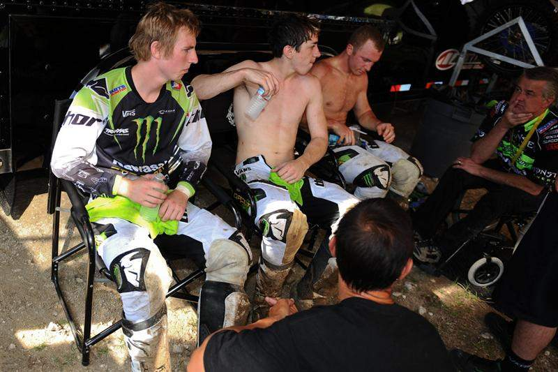 The Monster Energy/Pro Circuit Kawasaki team of Jake Weimer (left), Dean Wilson (middle) and Tyla Rattray (right) check in with Mitch Payton (far right) and Randy Lawrence (foreground) in the PC pits.