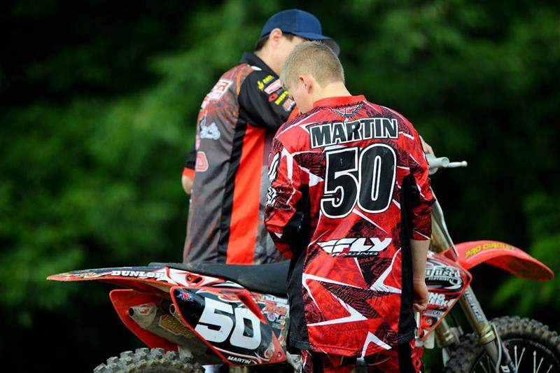 Alex Martin discussing settings with his mechanic.