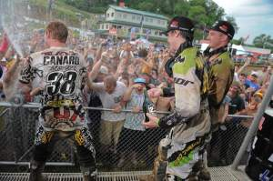 Trey Canard (38), Dean Wilson (middle) and Tyla Rattray (right) celebrate on the podium.