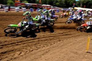 Christophe Pourcel grabs the holeshot at the start of the first 250cc moto over teammates Tyla Rattray (28) and Jake Weimer (12).
