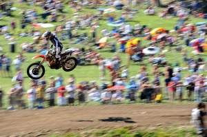 Trey Canard leads the second moto in front of many thousands of loud RedBud fans.