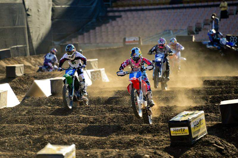 By the time the girls hit the whoops on the first lap, Ashley Fiolek (1) had the lead. Here, she leads Price (4), Jessica Patterson (2) and the rest of the field.