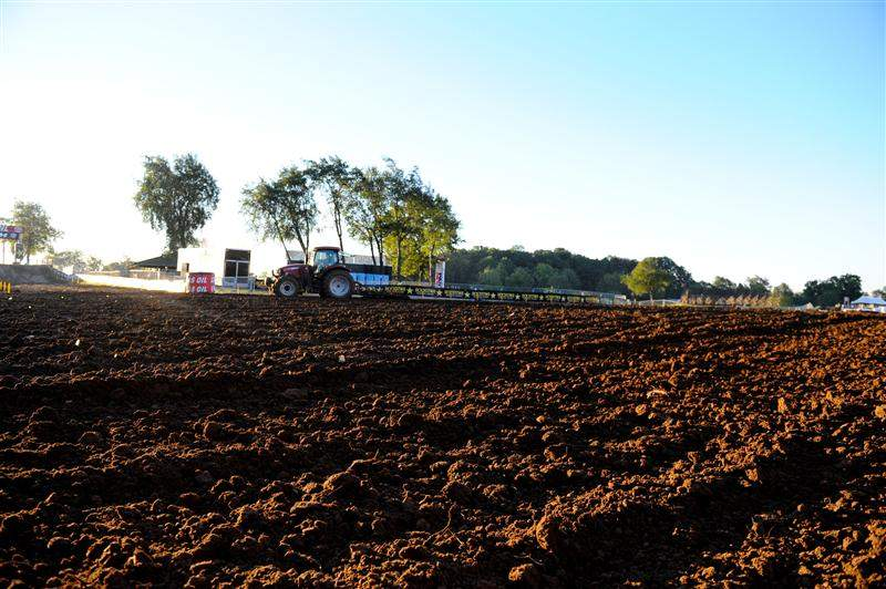 A tractor tills up the start straightaway at legendary RedBud Raceway.