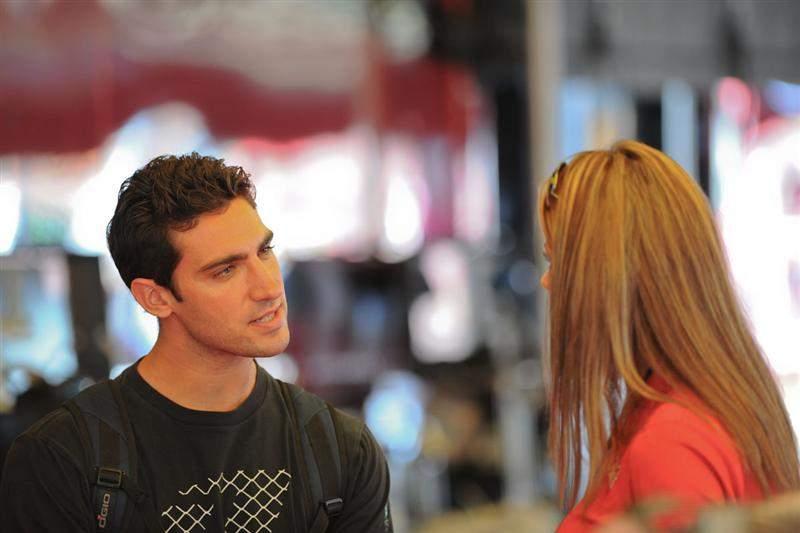 Sebastien Tortelli (left) talks with Erin Bates about training Blake Wharton.