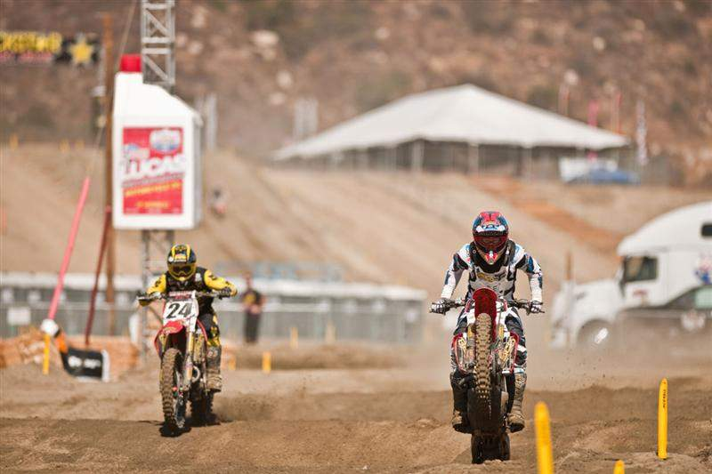 Trey Canard leads his teammate Brett Metcalfe through the sand whoops at Pala.