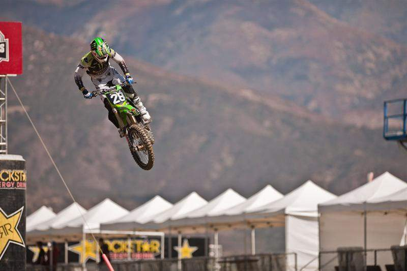 Rattray jumps over the big finish-line double in front of the grandstands at Pala Raceway.